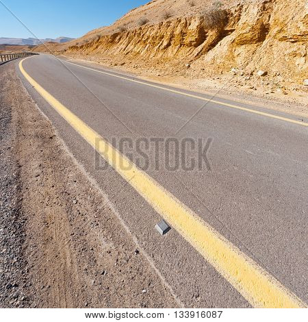 Winding Asphalt Road in the Negev Desert in Israel