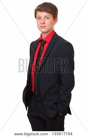 Portrait of a confident teenage boy wearing a suit on white background