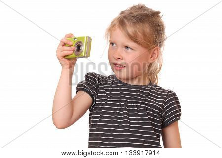 Portrait of a young girl with camera on white background