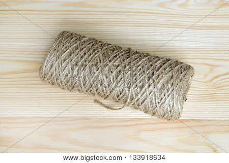 Roll of a twine jute on a wood.