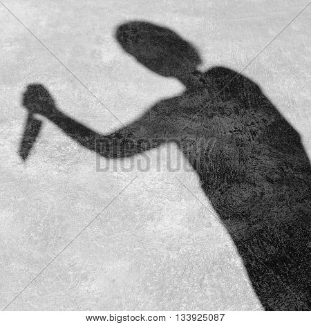 Shadow Man Raised A Knife To Stab
