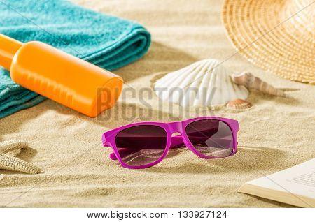 Beach vacation - Accesoires in the sand on the beach