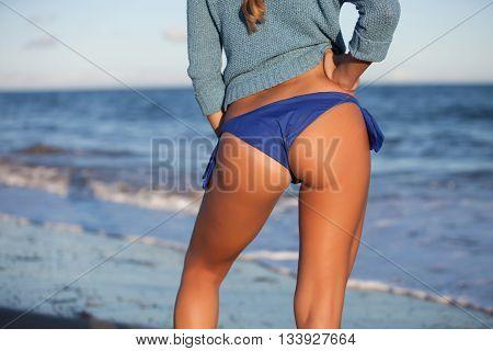 woman back and ass with bikini in seashore