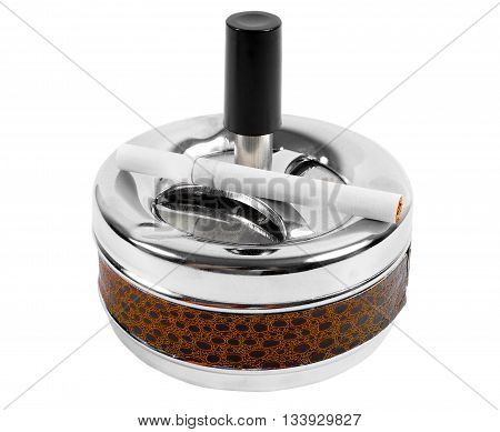 metal ashtray with sigarette isolated close up
