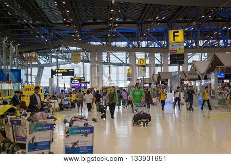 BANGKOK, THAILAND - May, 2016: Passengers and workers in the departure terminal of Bangkok Suvarnabhumi Airport, Thailand. Suvarnabhumi Airport is one of two international airports serving Bangkok.