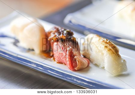 sushi or rice with grilled beef and grilled fish topping dish