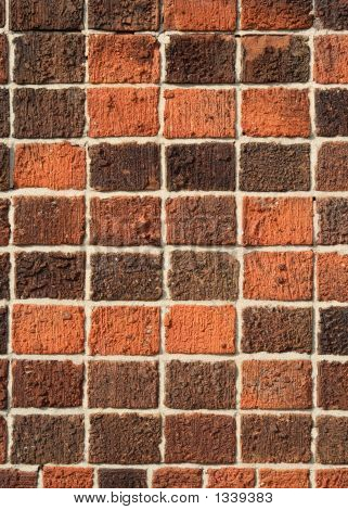 Vertical View Of A Square Red Bricks Wall.