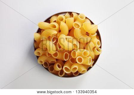 Macaroni dry pasta on white background