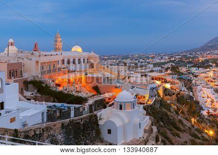 St. Gerasimos Christian Church of Fira, modern capital of the Greek Aegean island, Santorini, during twilight blue hour, Greece
