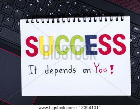 Word spell Success and handwriting It depends on you on notebook with laptop keyboard