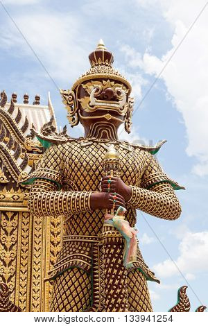 Giant Statue in Temple on sky background Thailand. Art vintage style in Places of worship.