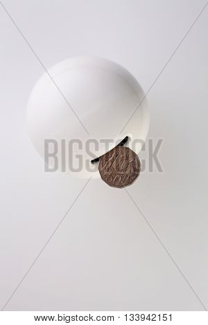 top view round saving coin box on the white background
