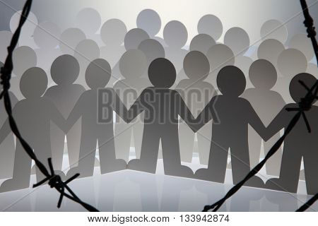 people chain behind of barbwire