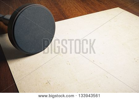 Round stamper and aged paper on wooden desktop. Mock up 3D Rendering