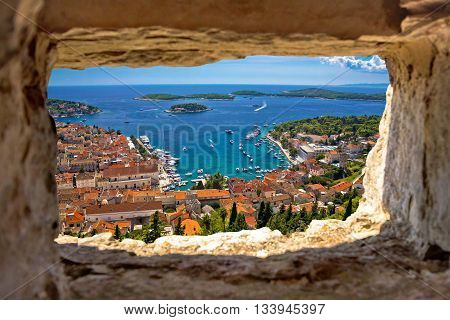 Hvar bay aerial view through stone window from Fortica fortress Dalmatia Croatia