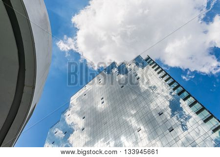 Beautiful cloud on glass building in day time