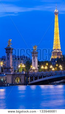 Paris France-June 11 2016 : The bridge Alexandre III and the Eiffel tower are the most visited monuments in Paris.