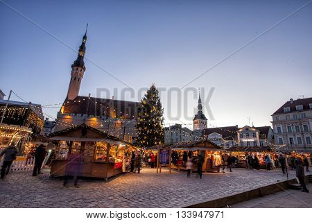 TALLINN, ESTONIA - DECEMBER 12, 2015: Traditional Christmas market in Tallinn old town. HDR image. Long time exposure with motion blur.