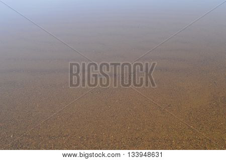 Sandy beach bottom relief natural background in spring
