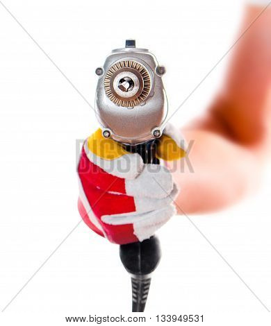gloved hand with drill isolated on white background