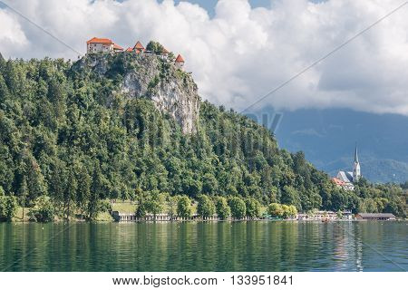 Photo shows a landscape of lake Bled Slovenia in summer.