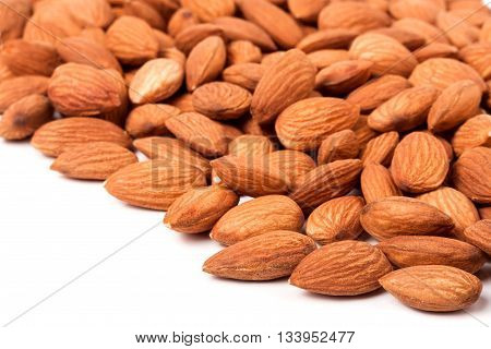 peeled almonds isolated on a white background .