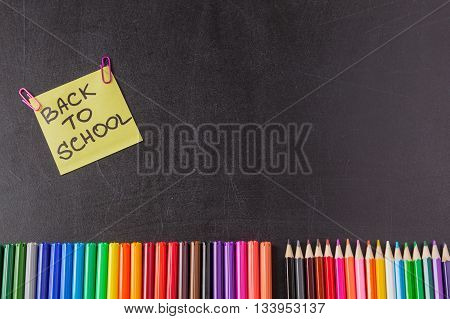 Back to school background with colorful felt tip pens pencils and title