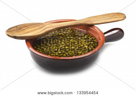 Bowl of green pepper grains close up