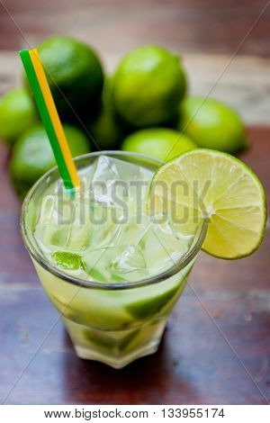 Caipirinha, a brazilian cocktail made of cachaça and lime on the table