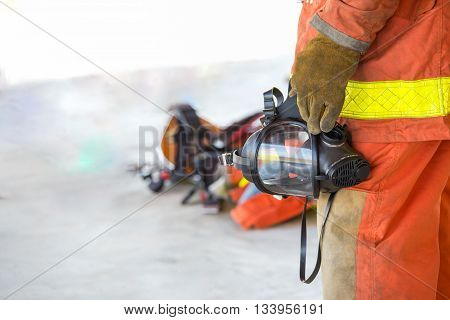 fireman hand in glove hold oxygen mask