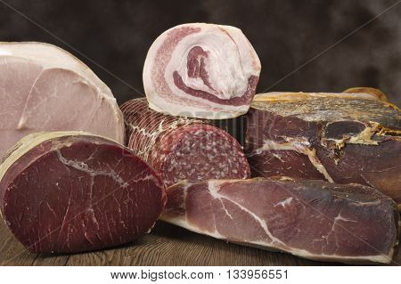 Mix of pork salami on the wood table