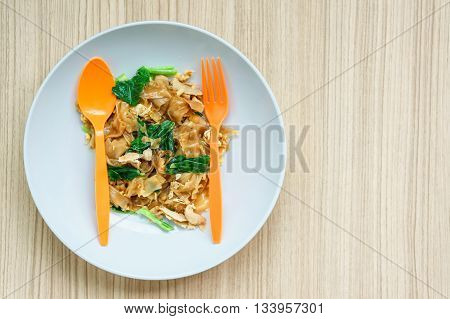 close up of Fried noodles with pork sauce. on wood table simply style