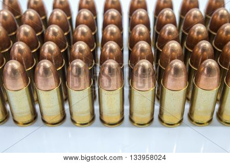 row of 9 mm full metal jacket bullet