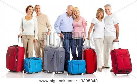 Senior couple travelers with bags. Isolated over white background