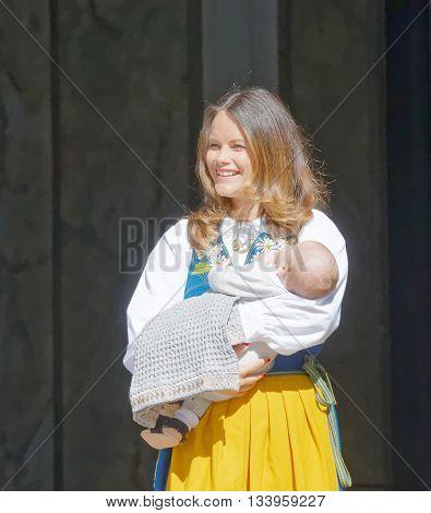 STOCKHOLM SWEDEN - JUN 06 2016: The smiling swedish princess Sofia Hellqvist holding her baby Alexander