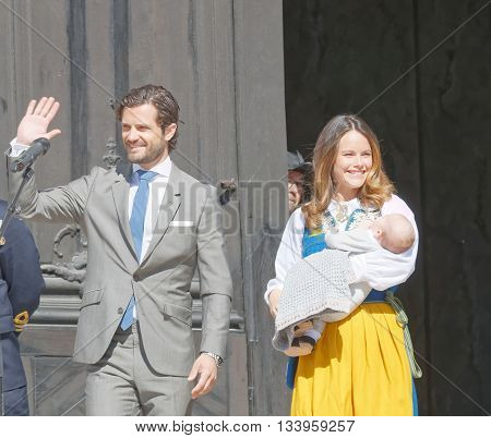 STOCKHOLM SWEDEN - JUN 06 2016: The swedish prins Carl Philip Bernadotte smiling and waiving to the audience and princess Sofia Hellqvist holding the newborn baby Alexander