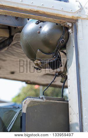 vintage helicopter helmet hold in helicopter cockpit
