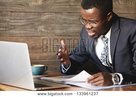 Disappointed African Businessman Is Dazed And Confused By A Mistake In Official Documents. His Bewil