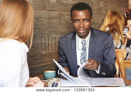 Job Interview And Employment Concept. Portrait Of Confident African Businessman In Glasses Looking A