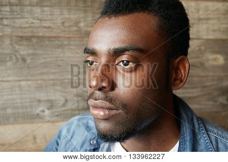Highly-detailed Profile Of Handsome Young African Man Wearing Denim Jacket Over White T-shirt Lookin