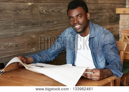 Lifestyle And People Concept. Portrait Of Handsome Young African American Student In Denim Clothes,