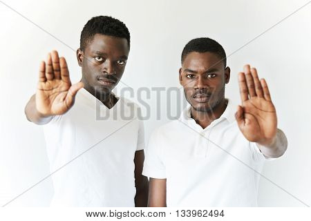 Film Effect. Portrait Of Serious Dark-skinned Students Or Employees Wearing White Clothes, Extending