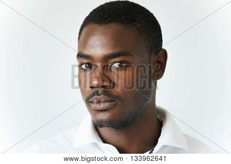 Half Profile Shot Of Attractive Young African Man With Moustache And Beard In Casual Clothes, Lookin