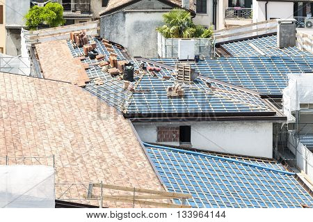 Construction site. Roof renovation with pallets of shingles
