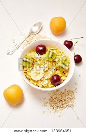 Healthy Breakfast with corn flakes berry apricot on white background.