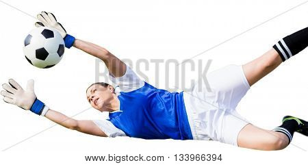 Woman goalkeeper stopping a shot on goal