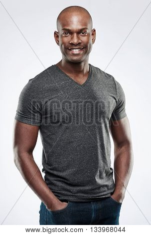 Handsome Fit Smiling Man With Hands In Pockets