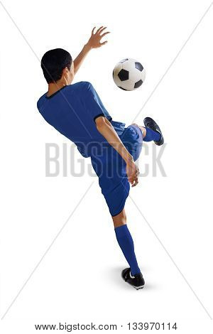 Portrait of football player kicking a soccer ball isolated on white background