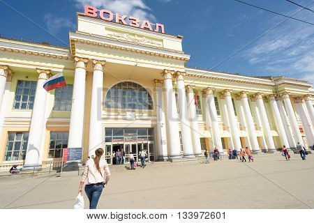 YEKERTERINBURG RUSSIA 20TH MAY 2016 - Main Train Station of Yekaterinburg in Russia with people entering the grand main line transport hub. Daytime image with sunlight.