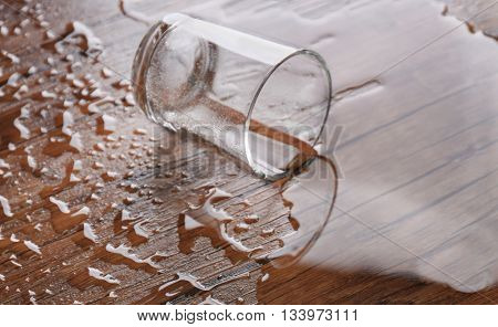 Overturned glass on wooden table
